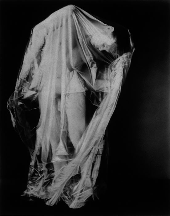 """Man in Plastic Bag #8,"" 1996, graphite on paper. 33 x 27 inches. Private collection."