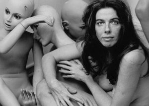 Manon posing nude with mannequins